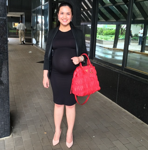 6d7f311e09e48 pregnant woman getting through a pregnancy without maternity clothes by  wearing black dress, black blazer, and nude heels, and red Prada nylon tote