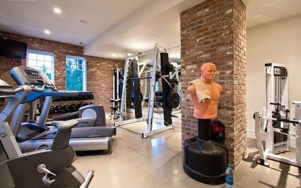 Nice home gym studio with machines, rack and punching bag