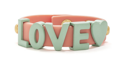 """Young love :  Beach-friendly and super cute! Rubber wrap bracelet with enamel lettering spelling out your favorite word, """"Love."""" Adjustable snap-button closure."""
