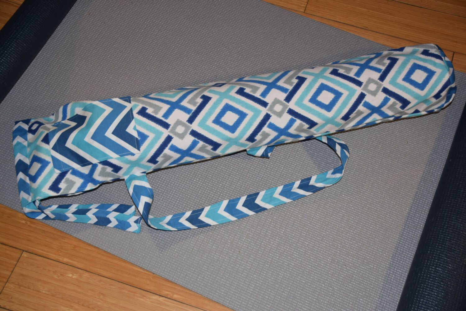 A personal favorite from my Etsy shop https://www.etsy.com/listing/215772420/yoga-mat-bag-yoga-mat-carrier-yoga-bag