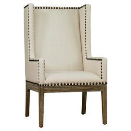 Wingback Arm Chair With Nailhead Trim And A Solid Wood