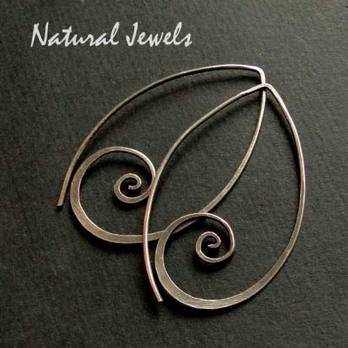 SILVER SPIRAL … Earrings totally handcrafted from wire of Sterling Silver. These earrings are so comfortable! You put the long pin through your ear and wow...