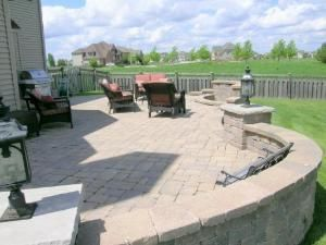 great paved deck and backyard