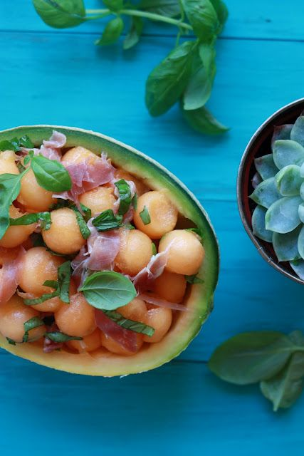 Melon, prosciutto, and basil salad served right out of the melon #YummyMummyKitchen