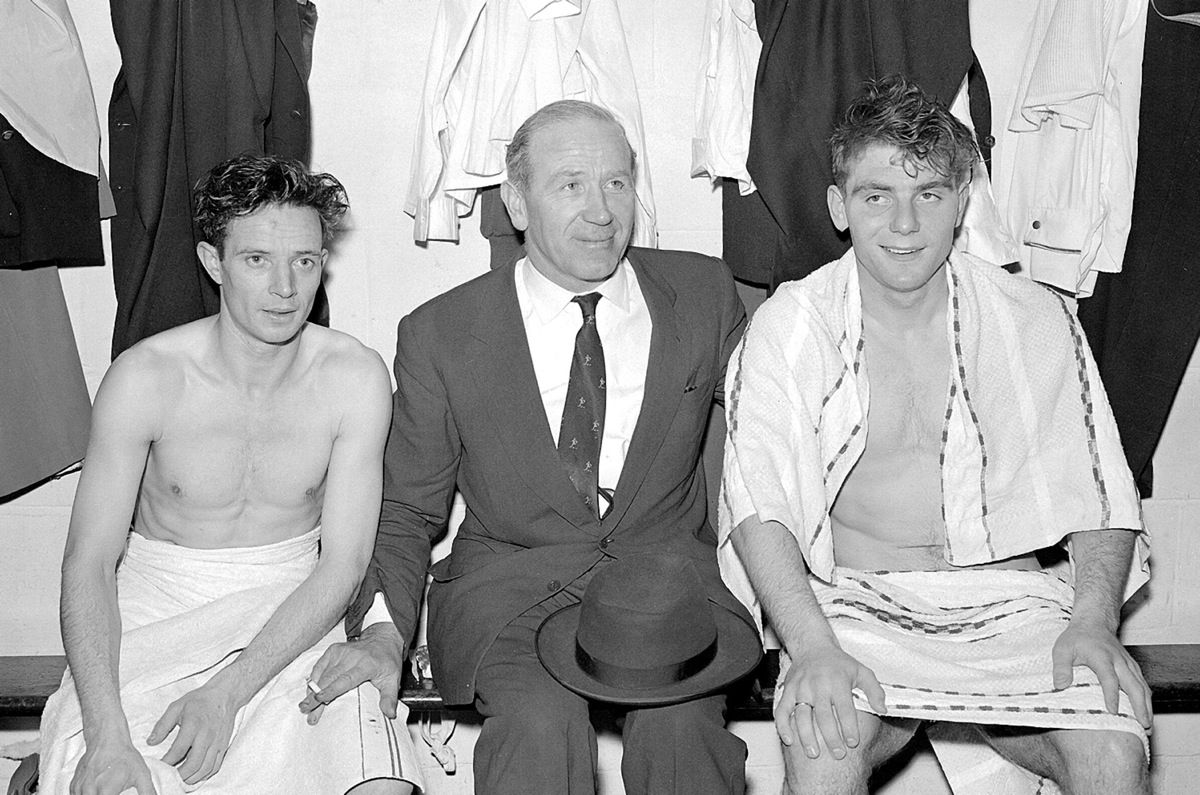 Manchester United manager Matt Busby between Johnny Berry (left) and Duncan Edwards (right), in the dressing-room at Bournemouth after United had qualified for the FA Cup semi final in March 1957. United reached the final that year, but lost 2-1 to Aston Villa