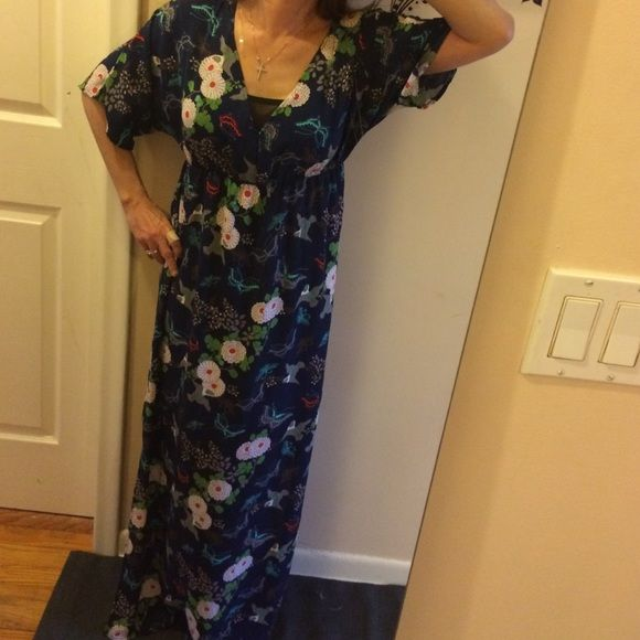 """Romeo & Juliet floral maxi dress BNWT. Love that the floral prints are so popular right now. Blue with a floral print and reminds me of a lumina style. Bust: 14@ elastic under bust: 12.5"""" sleeves: 13.5"""" sleeve width at end: 8"""". V neck down: 10"""". Top to bottom of dress: 54"""" slits on both sides: 20"""". White liner is 24"""" higher. So very slightly sheer on bottom. Liner gives comfort that you can't see anything underneath. Made of polyester. Retails for over 130$+. Plus free gift for all my buyers…"""