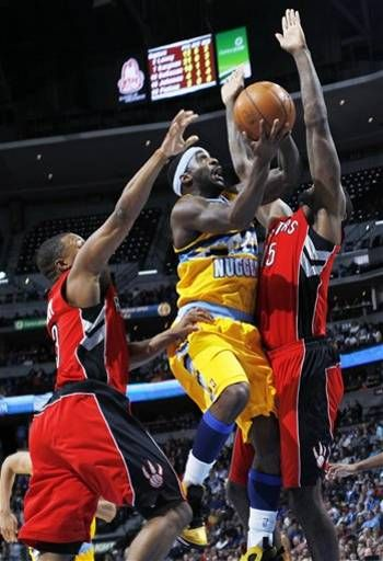 Denver Nuggets Guard Ty Lawson Center Goes Up For A Shot Between Toronto Raptors Guard Kyle Lowry Left And Center Amir Jefferson Toronto Raptors Nba Legends