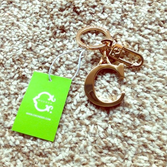 C. Wonder gold initial C keychain key fob PLEASE NO LOWBALLS. This collector's item from the now-defunct C. Wonder founded by Tory Burch's ex-husband is a gorgeous remnant from a quirky-yet-elegant brand. With a circle ring for your car and house keys and a clip for small keys like your locker, this keychain has a gold-plated C dangling to show off your initial of that of a loved one. Condition: new with tags! C. Wonder Accessories Key & Card Holders