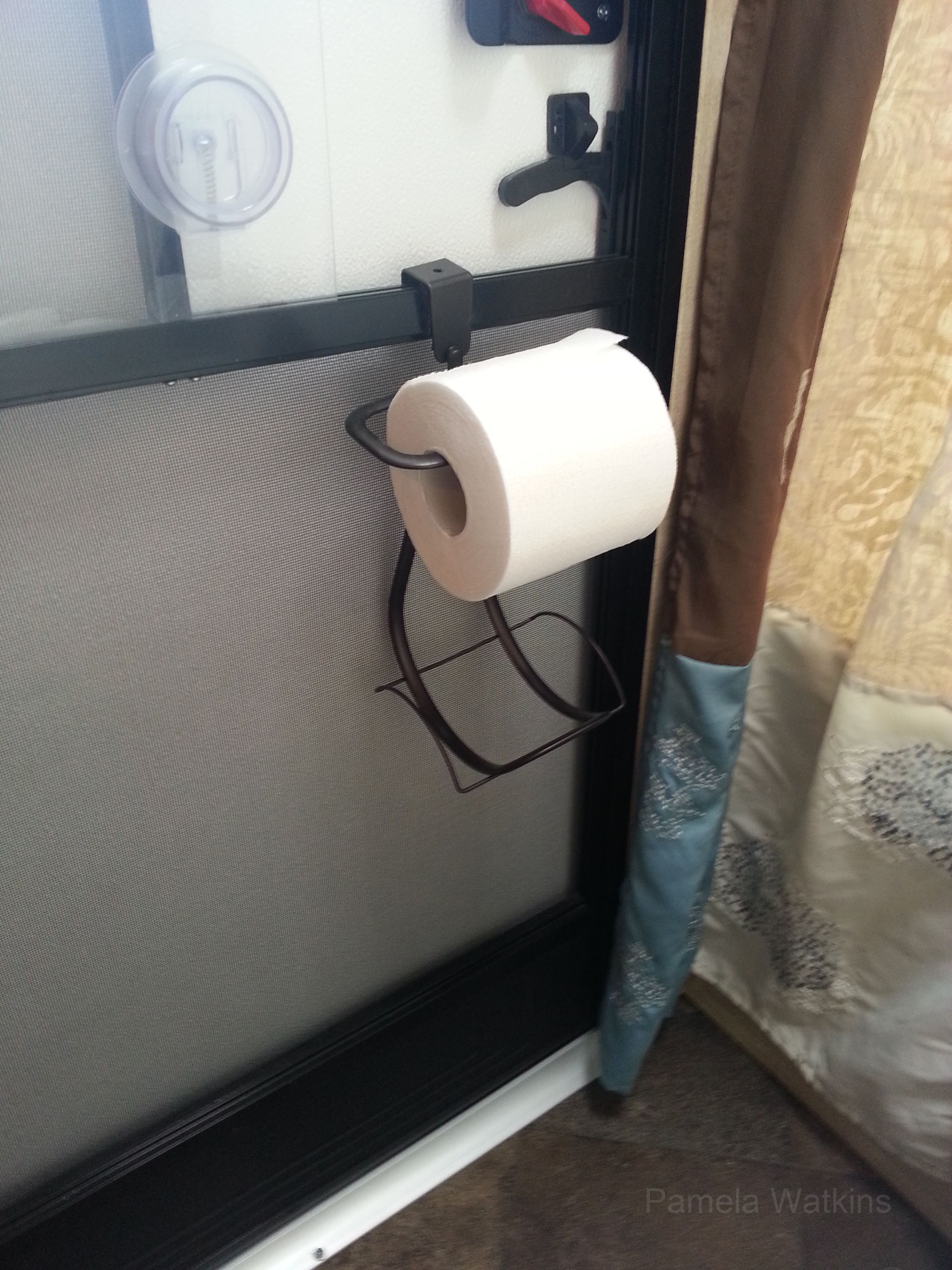 Toilet paper holder for camper. Attached with velcro. http://www ...