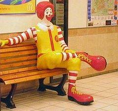 Ronald McDonald statue on a bench