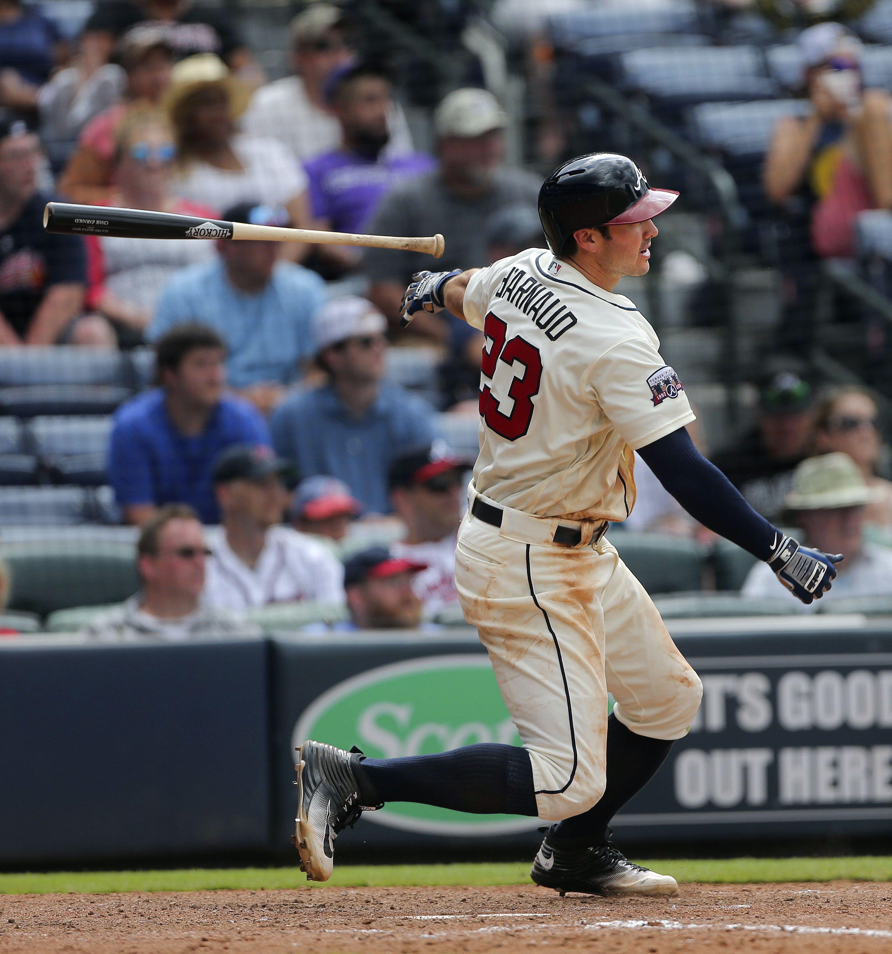 Atlanta Braves shortstop Chase d'Arnaud follows through on