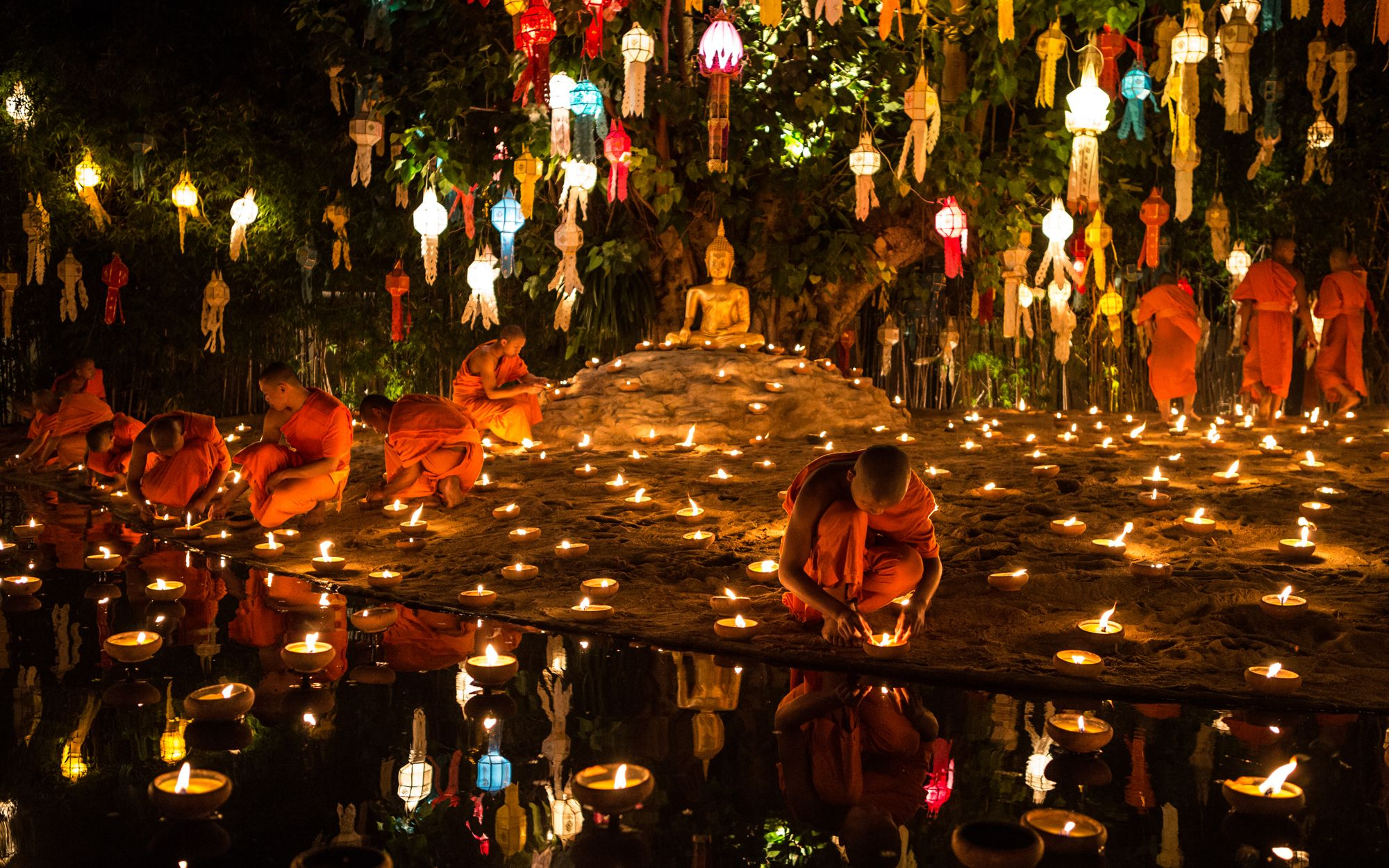 """Loi Krathong, Thailand & Laos: Loi Krathong means """"to float a basket"""" and in Thailand, along with parts of Laos, this festival involves sending decorated baskets (known as krathongs) down river and decorating the home with candles."""