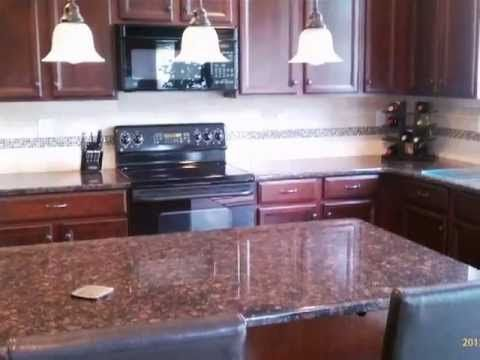 This Tan Brown Granite Color Was Fabricated With A Half Bullnose Edge This Concord Kitchen With Dark Wood C Brown Granite Tan Brown Granite Dark Wood Cabinets