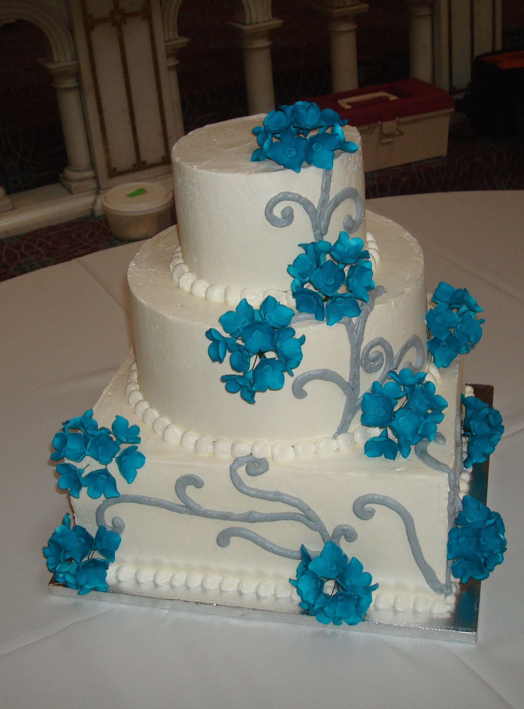 Traditional wedding decor blue and white  White  tier wedding cake with blue flowers  Weddings  Pinterest