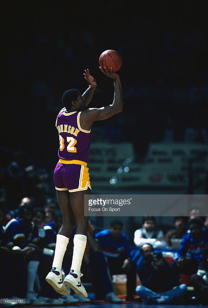 a8a300e66f94 Earvin Magic Johnson  32 of the Los Angeles Lakers shoots a jump shot  against the Washington Bullets circa 1984 during an NBA basketball game at  the Capital ...