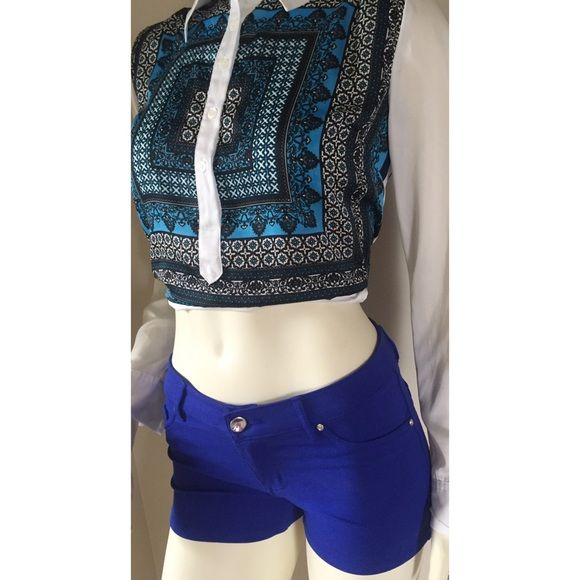 """Cisono royal cobalt blue bodycon mini shorts fit 2 SIZE MEDIUM ON TAG! But these run very small. I bought them while being rushed out of the store by my oh so patient husband. Needless to say they don't fit and need a new home. I tried them on and washed but never wore them out. They will not fit bigger than a 2. Very tight like a bodycon fit. Not high waisted. Measures: waist across 13"""". Inseam 2"""". Shown in the photo the stitching on back pocket is not perfect but doesn't affect the wear…"""