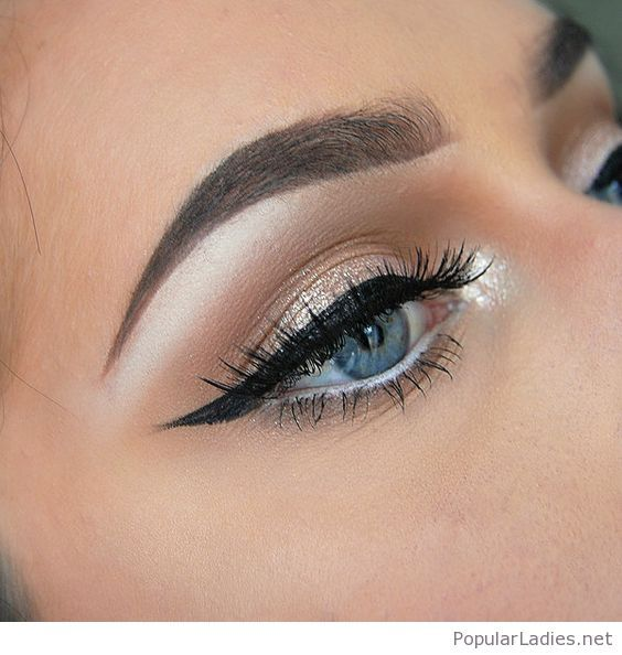 Golden Eye Makeup With A Black Line Prom Blue