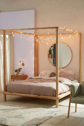 Wooden Canopy Bed With String Lights