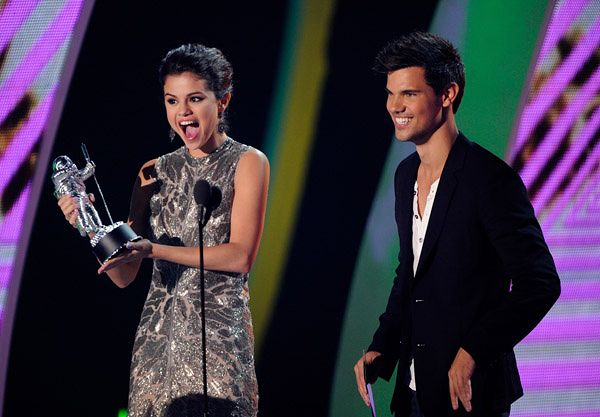 A werewolf and a wizard, Taylor Lautner and Selena Gomez, call Tyler, The Creator up to the stage to present him with the trophy for Best New Artist at the 2011 MTV Video Music Awards in Los Angeles. | MTV Photo Gallery
