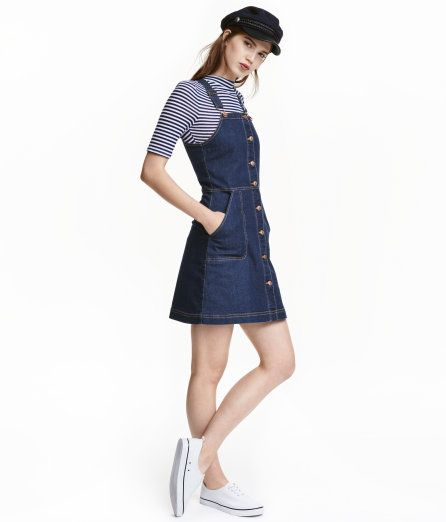 f1916fd4b38 Short bib overall dress in washed stretch denim with buttons at front.  Adjustable suspenders