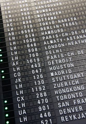 Arrival and departure board at airport terminal of Frankfurt stock photo