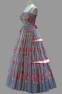 Pale blue dress with cherry blossom embroidery and pink satin bows worn by Queen Elizabeth II in 1959.  I love the design and the fabric.