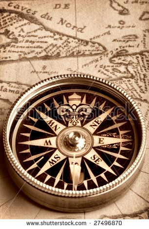 Compass on old handwritten map