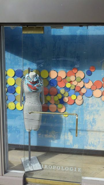 Anthropologie window display: paint can lids