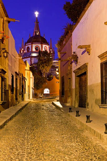 Nighttime street scene with La Parroquia in background, San Miguel de Allende, Mexico