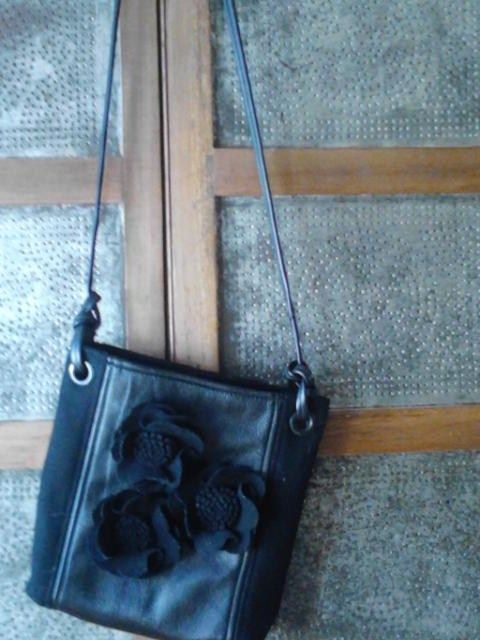 Upcycled bag created from black wool felt coat and a leather jacket.