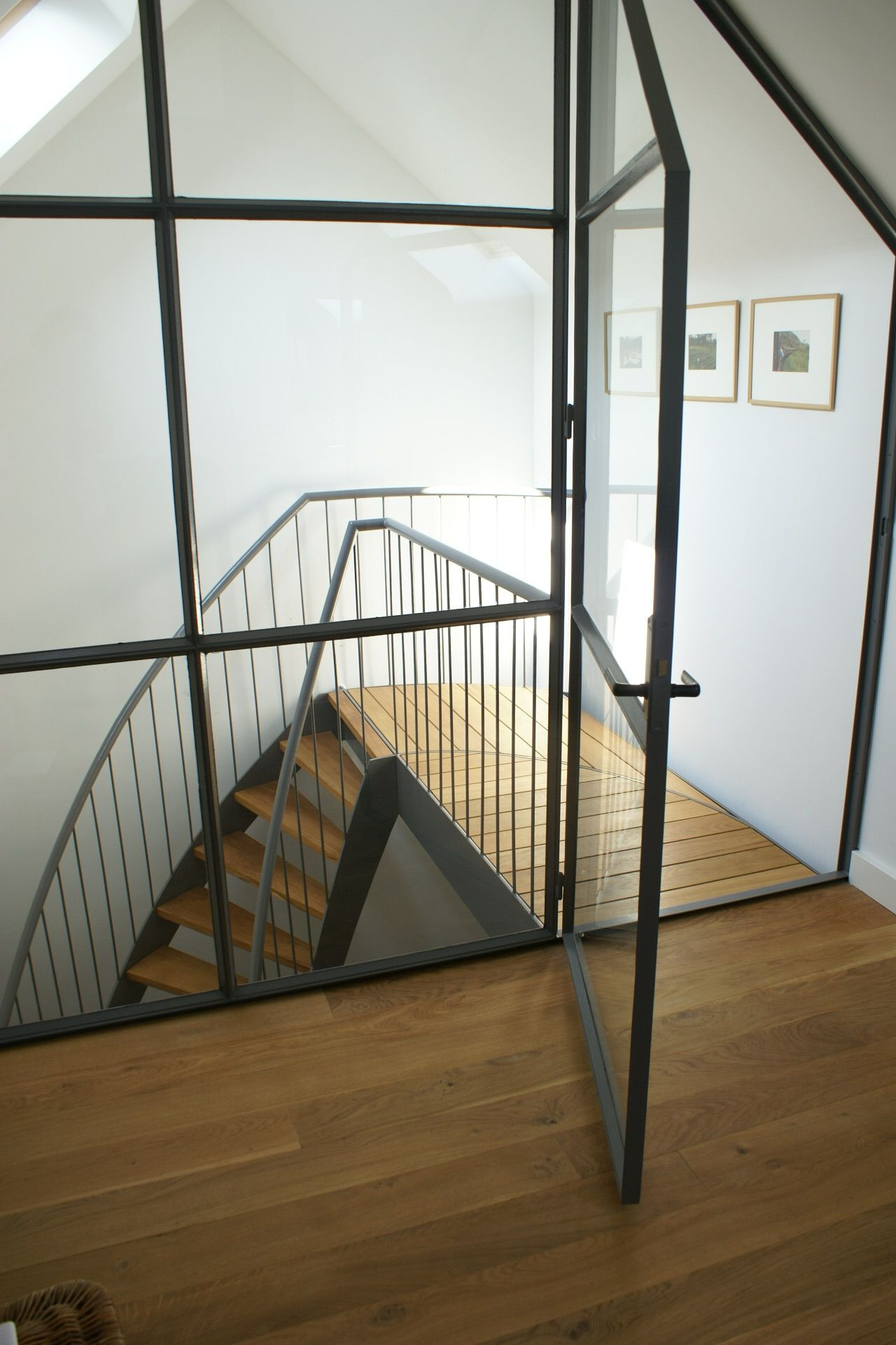 Bedroom Framed Wall, Wooden Floor, White Stucco, Steel Stairway Slaapkamer