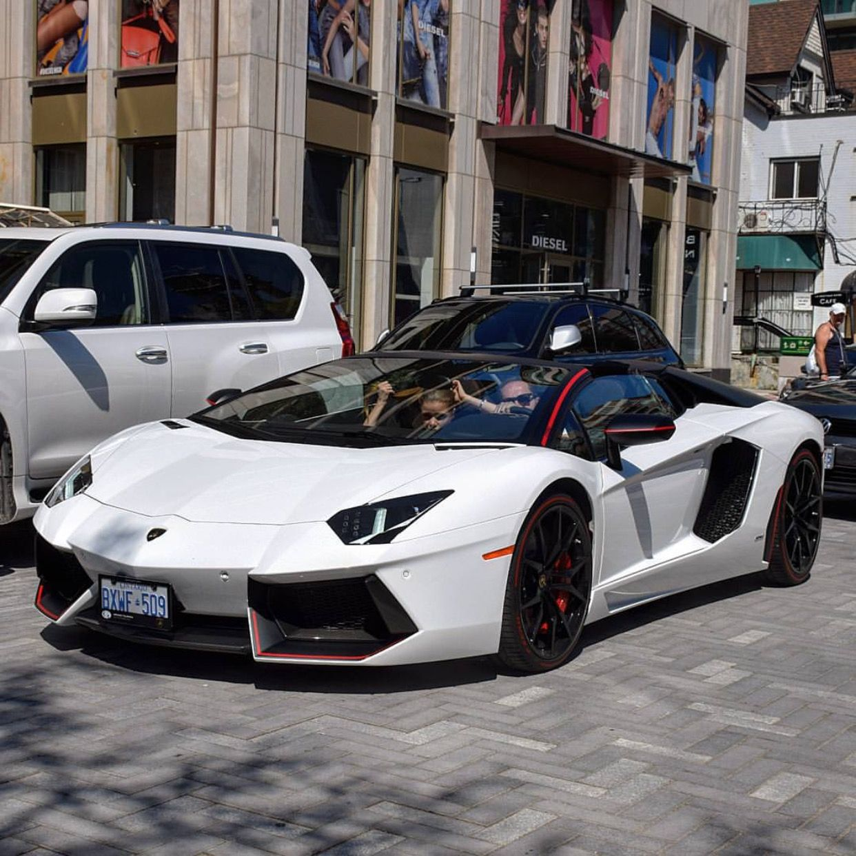 """Lamborghini Aventador Roadster """"Pirelli"""" Edition painted in Bianco Isis w/ red accents Photo taken by: @torontocarspotter on Instagram"""