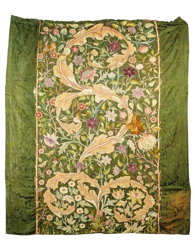 Morris & Co., designed by J.H. Dearle A RARE EMBROIDERED WALL HANGING with large scrolling acanthus leaves surrounded by flowers and foliage, a red squirrel and a nightingale perched amongst branches, worked in polychrome silks in stem, darning and satin stitches, on a dark green damask ground patterned with William Morris' 'Oak' design 263cm. long by 218cm. wide; 8ft. 7½in., 7ft. 2in. designed circa 1895