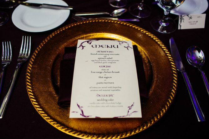 Modern Jewish Wedding | Modern Jewish Wedding Blog. Photography by Cathy and David Photographers. Trees, twigs and plenty of purple and gold for this Lord of the Rings reception. #Gold #charger #weddingmenu