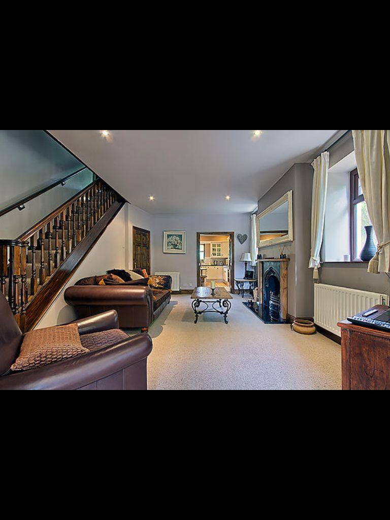 Grey living room, brown sofas, brown bannister railings