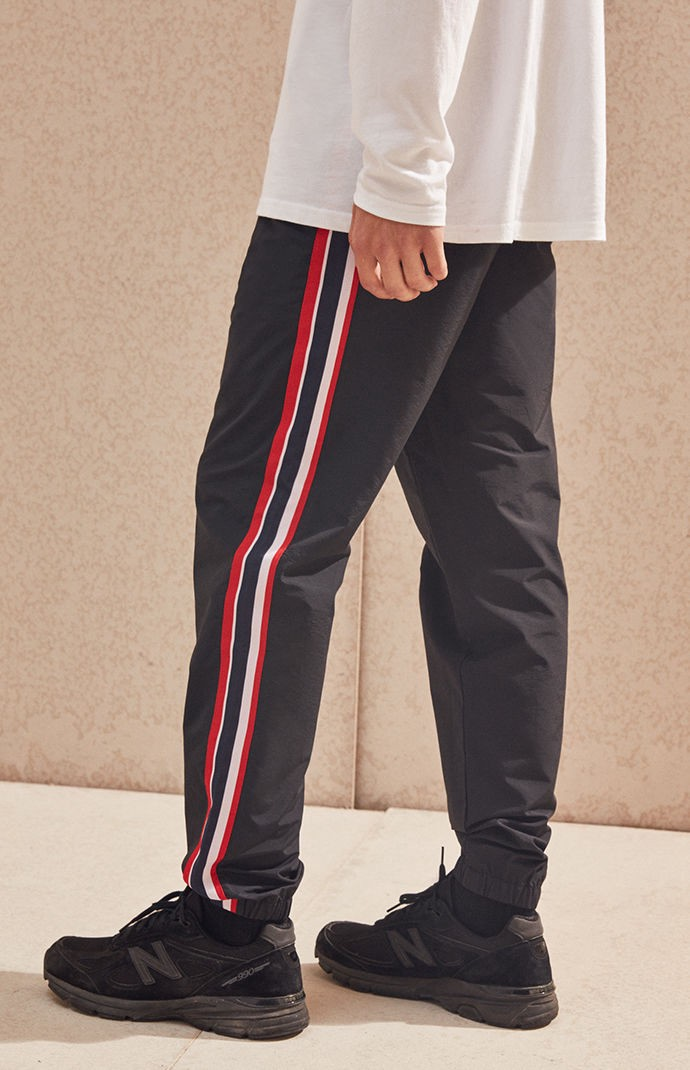 b65a382b9 Achieve effortless cool in these go-to PacSun pants. The Nylon Side Stripe  Stadium Track Pants have front and back pockets, a lightweight nylon  fabrication, ...