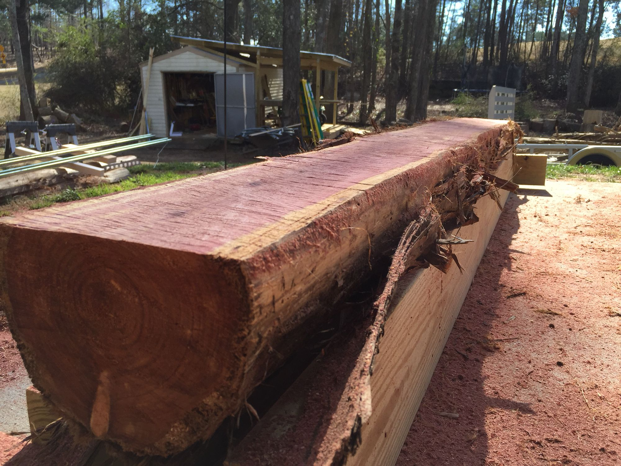 Elegant firepit with unpolished panel of oak wood using ornamental - Eastern Red Cedar Lumber Chainsaw Milled