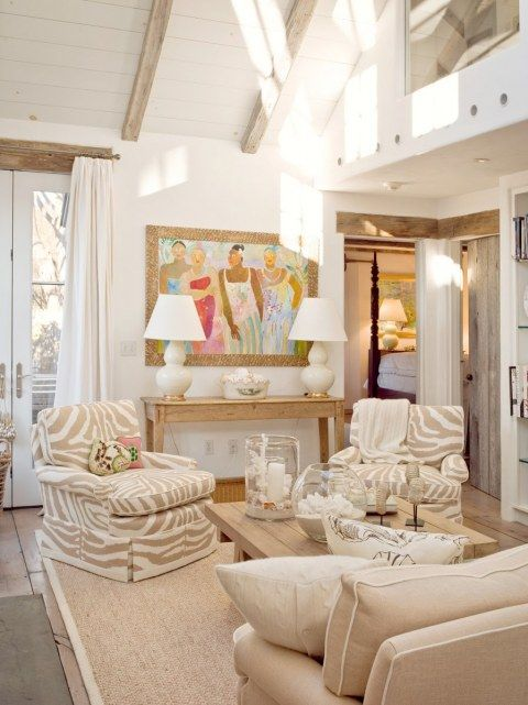 Boxwood Interiors living room. Beige and white zebra upholstered armchairs chairs, white curtains and lamps, beamed ceiling.