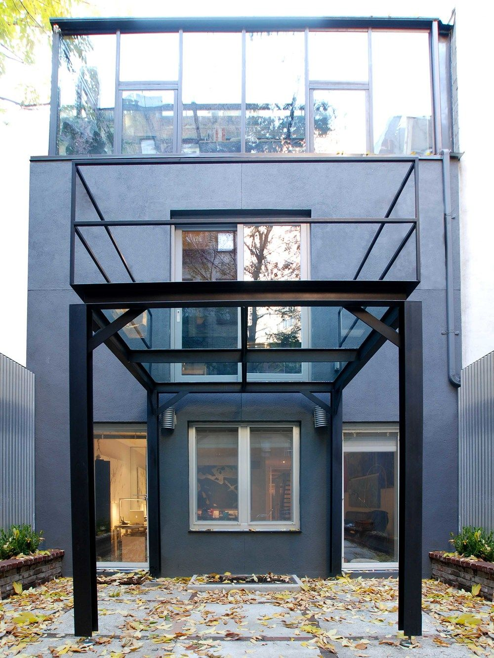 Blackened steel Ibeams and structural steel harmonize