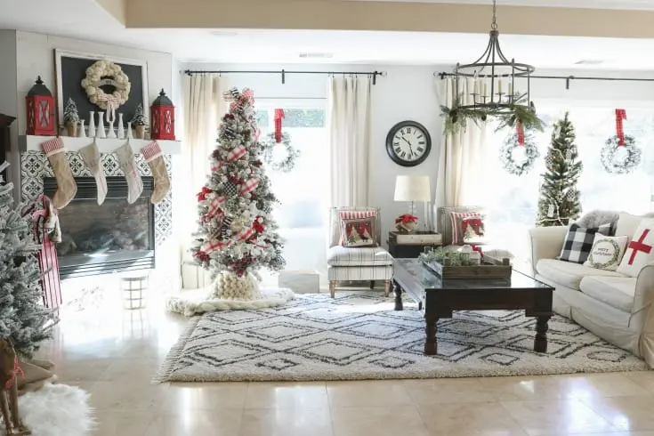 Enjoy my festive buffalo check Christmas Home Tour, complete with how-to's, inspiration, decorating tips, and plenty of sources to create holiday magic in your own home. Enjoy savings coupons to shop beautiful Christmas decor. #christmashome #christmashomedecor #festiveholidayhome #buffalocheck #thedesigntwins
