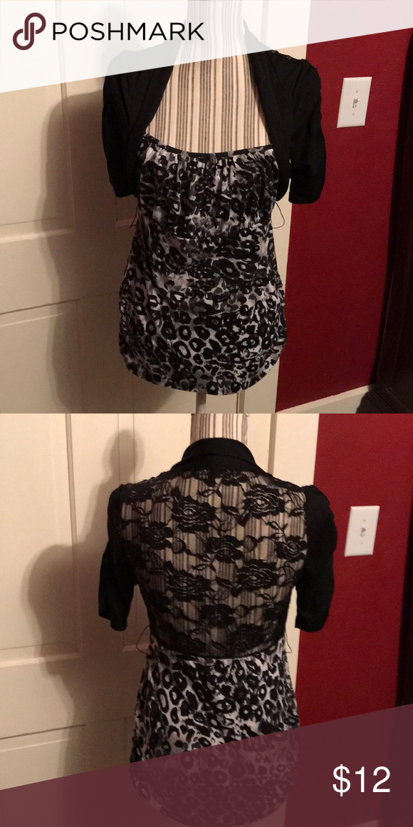 35dd5fd2ef3 Blouse Black and white leopard print blouse with attached shrug. Has belt  loops (belt missing