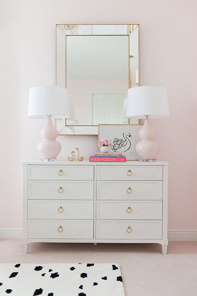 nursery with white furniture. blush lamps walls and carpet with white furniture touches of gold add nursery t
