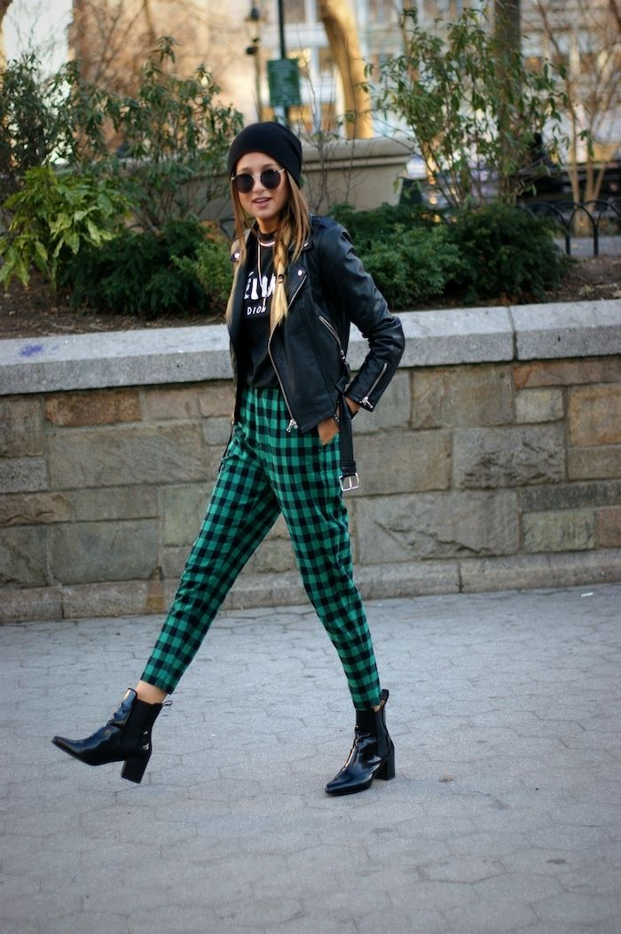 Green tartan trousers teamed with a leather jacket. She is ...