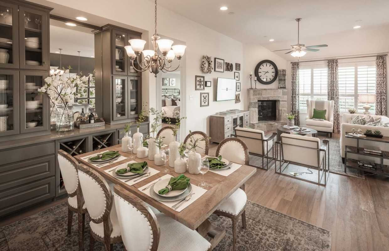 A Sophisticated Open Concept Dining And Living Room Harmony Highlandhomes Houston Living Dining Combo Dining Room Combo Living Dining Room #open #concept #dining #room #living #room