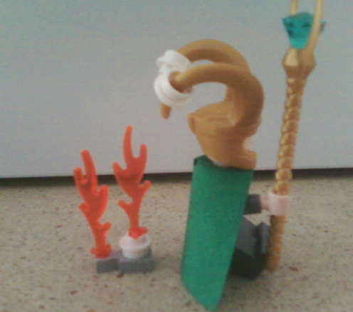 Lego Loki roasting marshmallows on his goat hat.  LOVE IT!