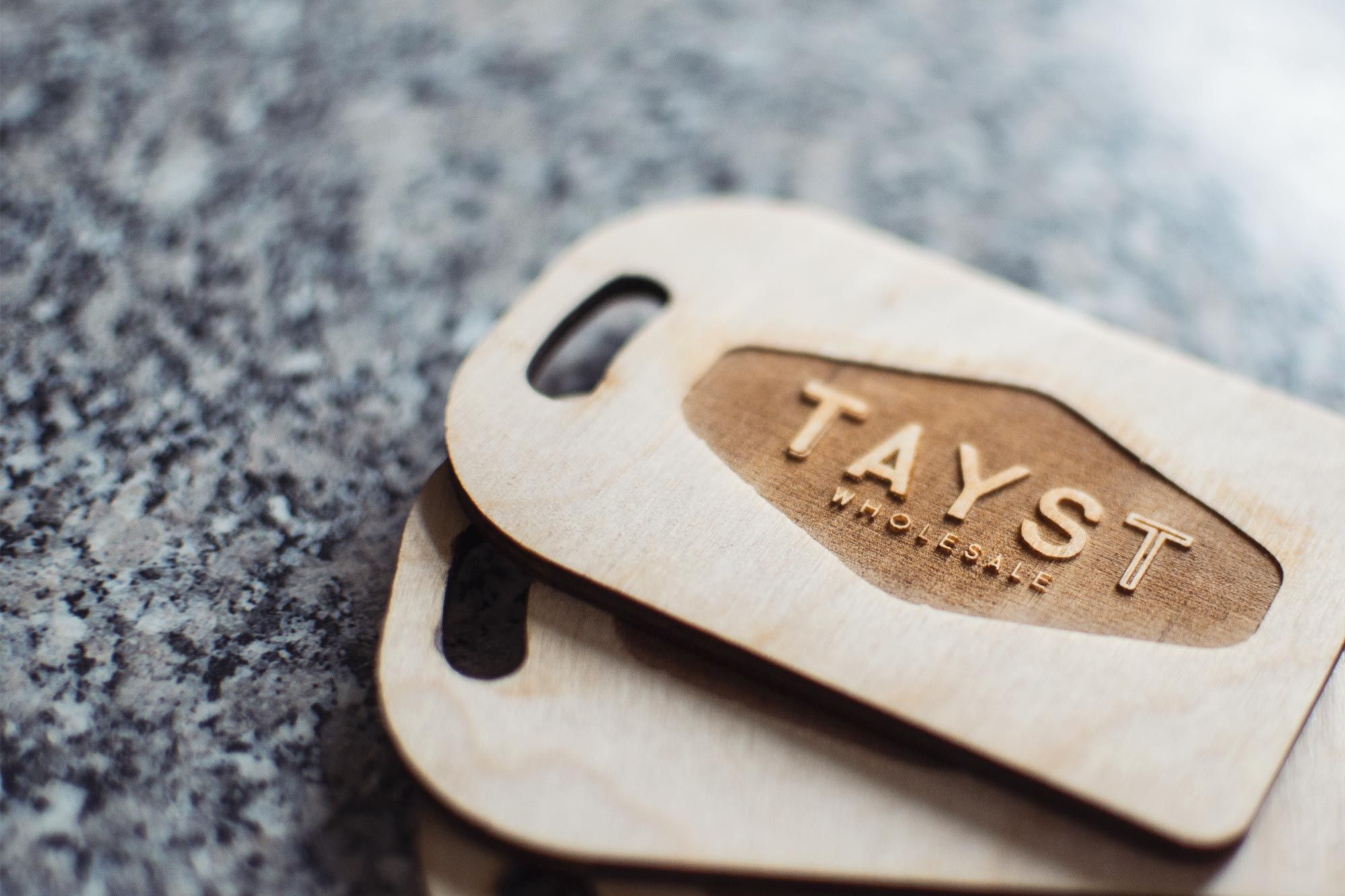 Bespoke laser engraved chopping board business cards for TAYST