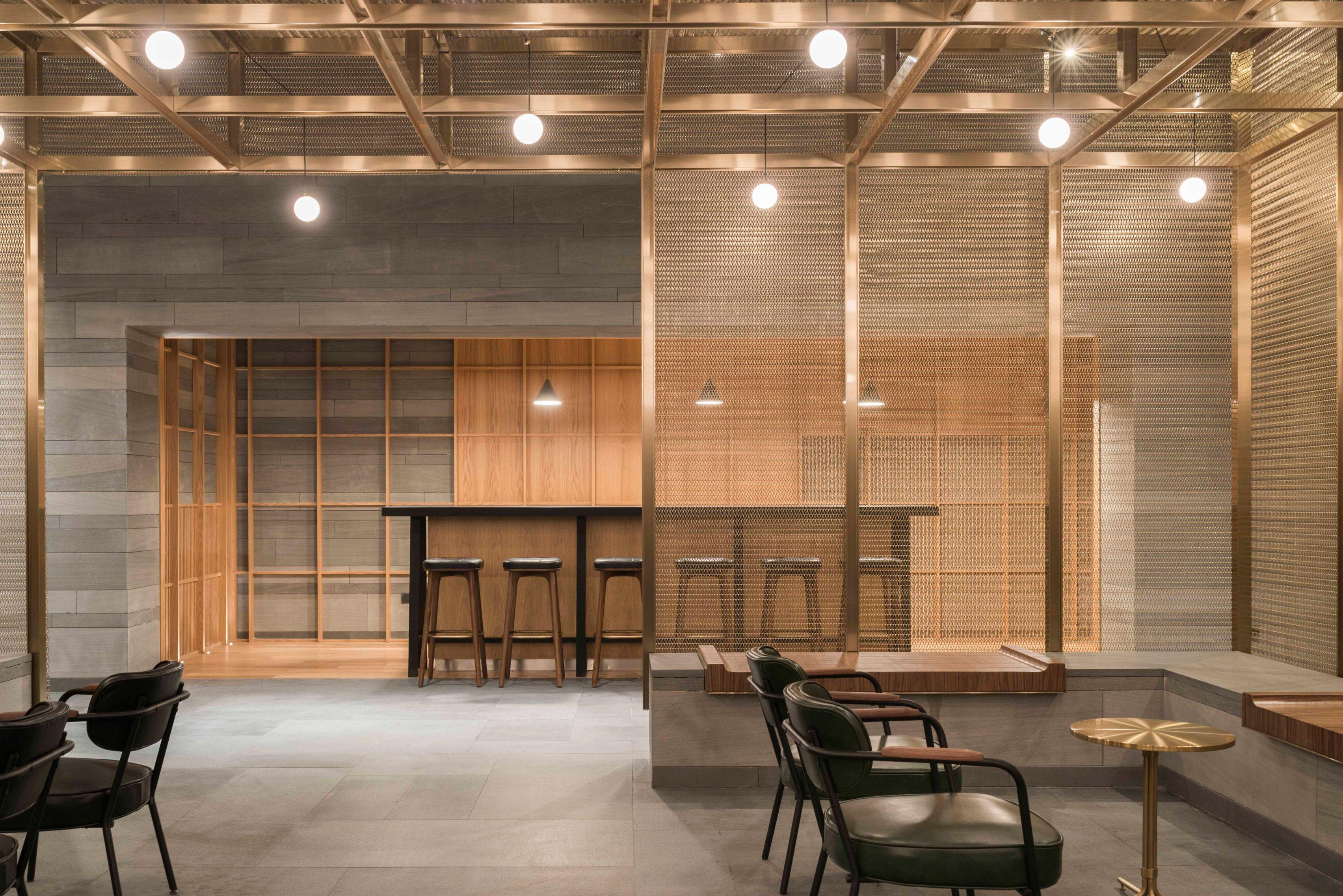 neri&hu has used wood-covered sticks and sandstone slabs to create