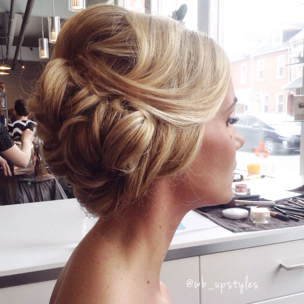 swept back. loose updo. bridal hairstyles. off to the side. blonde