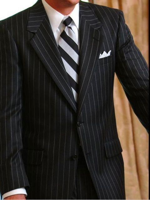 Groom Pinstripes And A Cross Stripe Tie