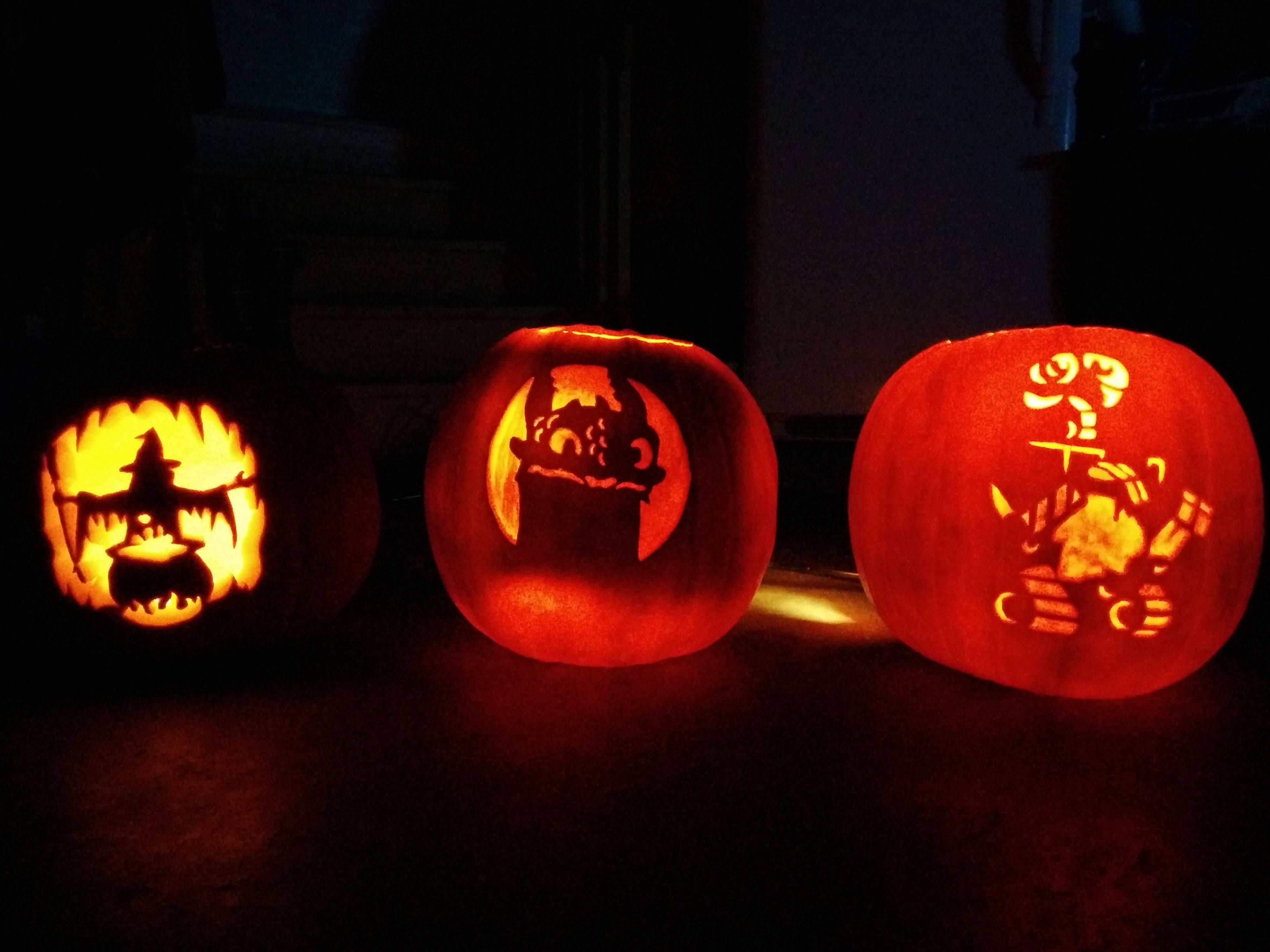 pumpkins by the gf and I this year... People keep asking 'what the third one is'... Help me out here reddit!